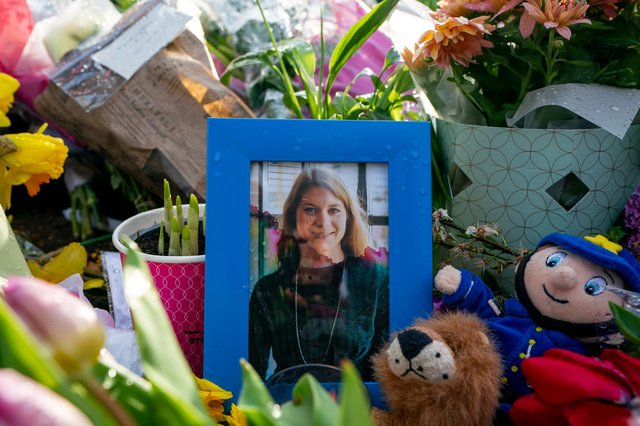 A picture of Sarah Everard sits among flowers left at the bandstand on London's Clapham Common where floral tributes were left in her memory (Picture: Ming Yeung/Getty Images)