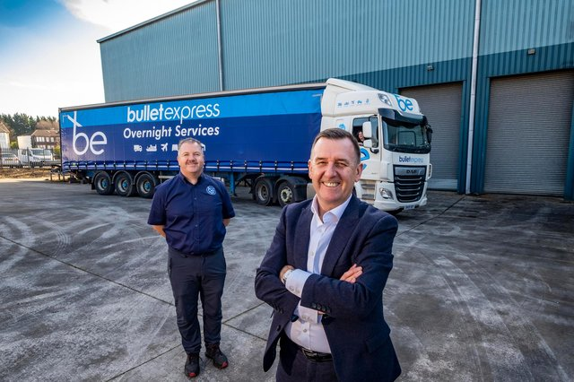 David McCutcheon, joint CEO, and John McKail, MD, Bullet Express outside new logistics storage facility with Andrea Gardner at the wheel of the truck. Picture: Peter Devlin