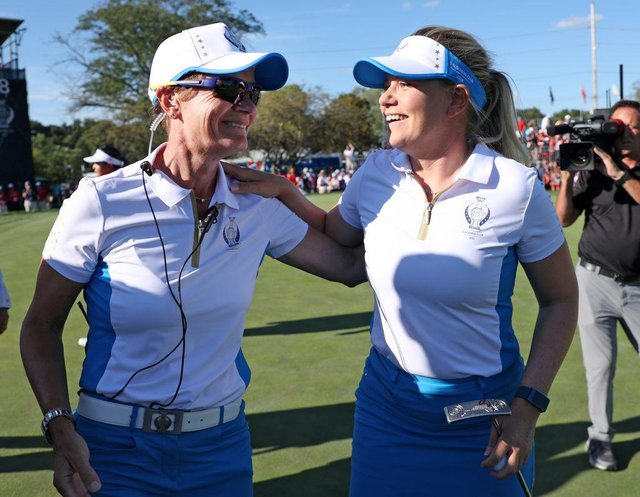 European captain Catriona Matthew congratulates Matilda Castren after the Finnish player had retained the Solheim Cup at the Inverness Club in Toledo, Ohio. Picture: Gregory Shamus/Getty Images.
