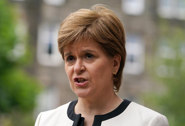 First Minister Nicola Sturgeon has said the pandemic could continue to put 'huge pressure' on the NHSafter Scotland recorded the highest ever daily total of new cases and the most deaths since April (Photo: Andrew Milligan/ PA Wire).