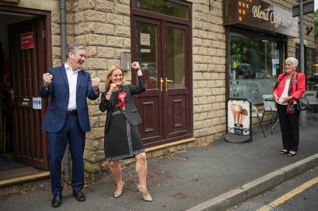 Kim Leadbeater, sister of the murdered MP Jo Cox, and Labour leader Keir Starmer celebrate her narrow victory in the Batley and Spen by-election as her mother Jean Leadbeater looks on (Picture: Christopher Furlong/Getty Images)